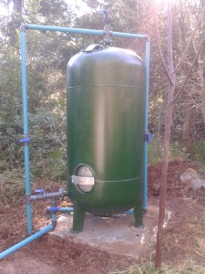 Limestone contact tank for partial stabilisation of corrosive ground water